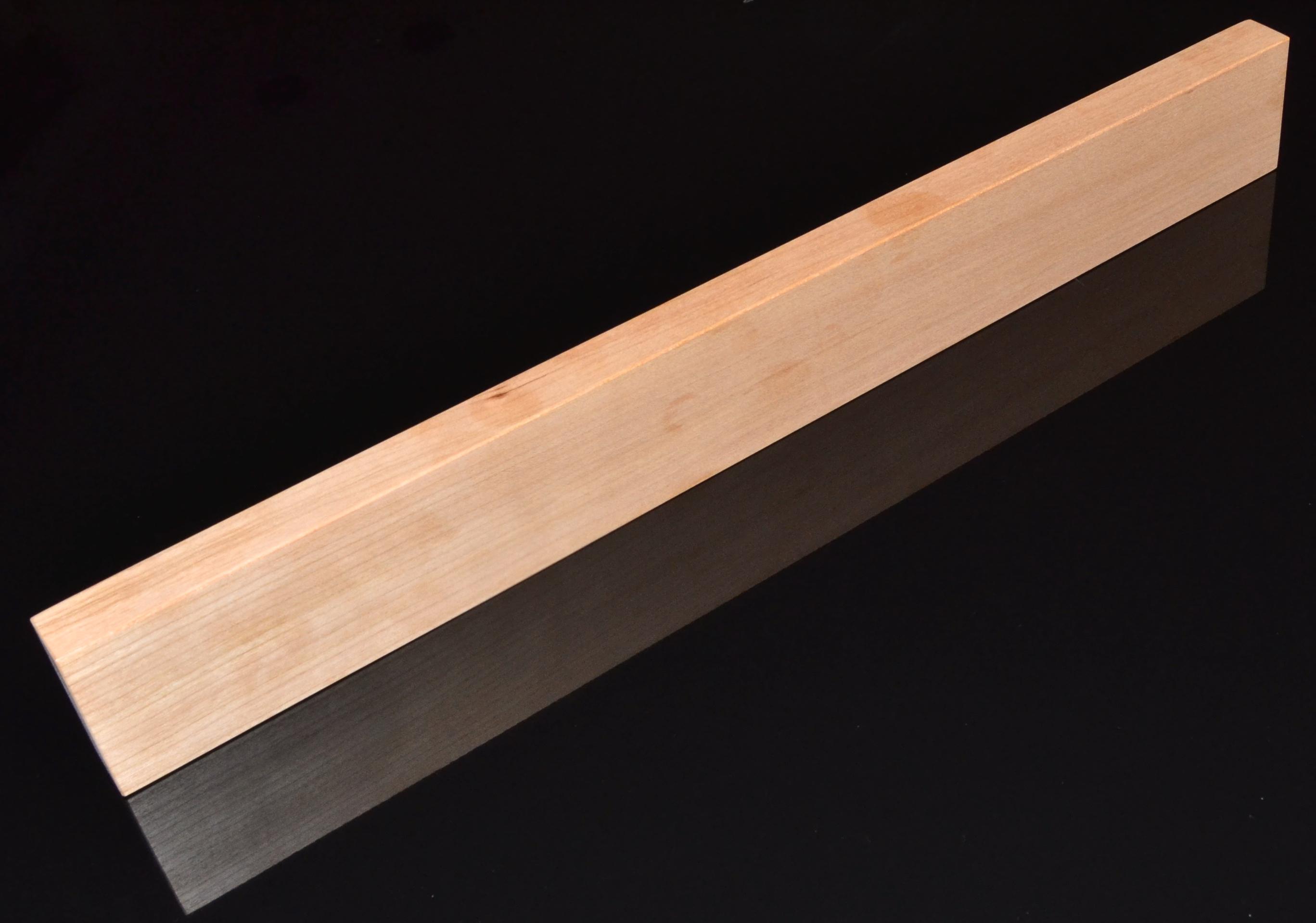 Image of   Knivmagnet i kirsebærtræ 7 knive 45 cm